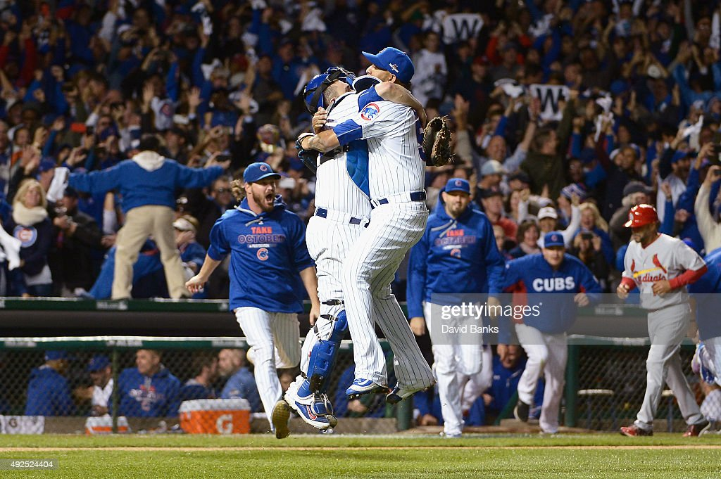 Miguel Montero #47 of the Chicago Cubs celebrates with Hector Rondon #56 of the Chicago Cubs after defeating the St. Louis Cardinals 6-4 in game four of the National League Division Series at Wrigley Field on October 13, 2015 in Chicago, Illinois.