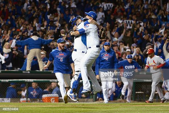 Miguel Montero of the Chicago Cubs celebrates with Hector Rondon of the Chicago Cubs after defeating the St Louis Cardinals 64 in game four of the...