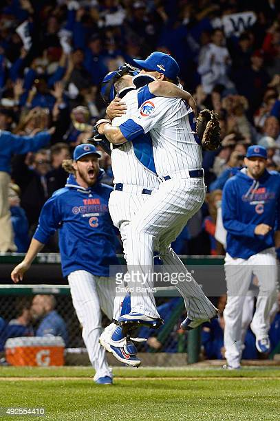 Miguel Montero of the Chicago Cubs celebrates with Hector Rondon of the Chicago Cubs after defeating the St Louis Cardinals in game four of the...