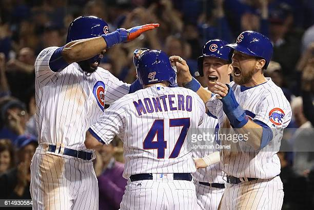 Miguel Montero of the Chicago Cubs celebrates with Jason Heyward Chris Coghlan and Ben Zobrist after hitting a grand slam home run in the eighth...