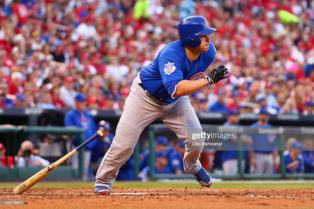 Miguel Montero of the Chicago Cubs drives in a run in the third inning against the St Louis Cardinals during game two of the National League Division...