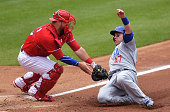 Miguel Montero of the Chicago Cubs gets tagged out at home by Cameron Rupp of the Philadelphia Phillies in the third inning at Citizens Bank Park on...