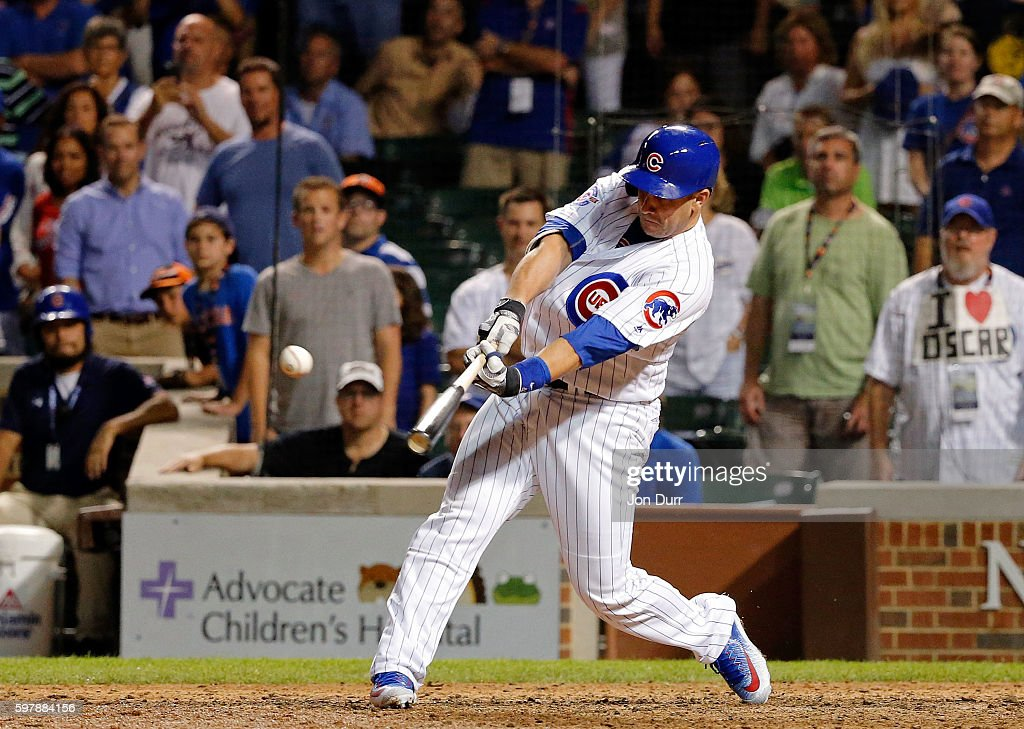 Miguel Montero of the Chicago Cubs hits a walkoff RBI single against the Pittsburgh Pirates during the thirteenth inning at Wrigley Field on August...
