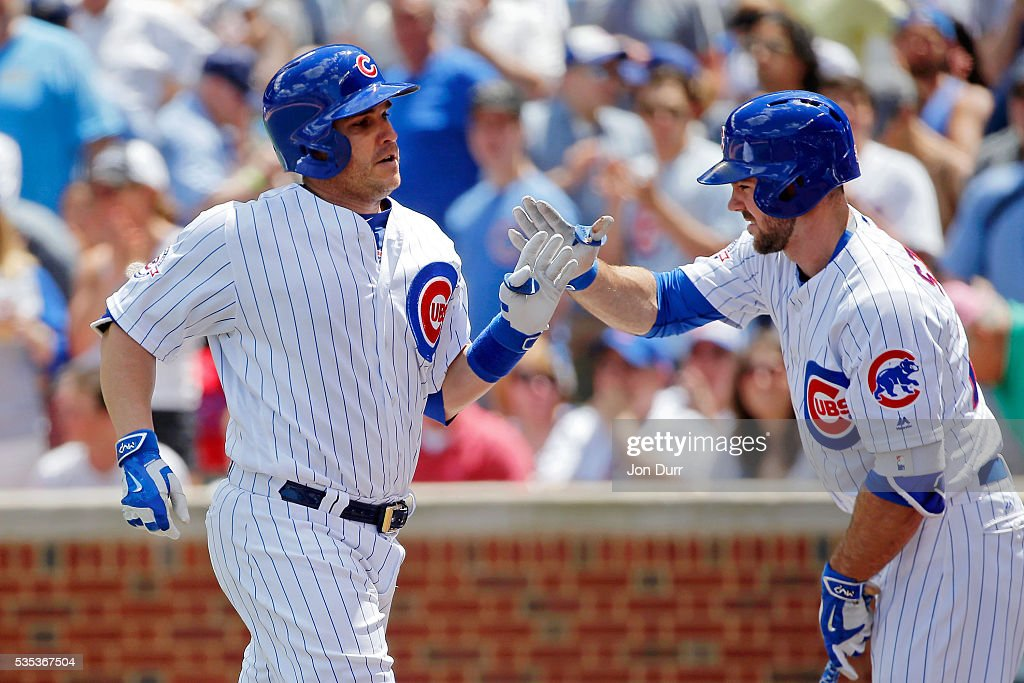 <a gi-track='captionPersonalityLinkClicked' href=/galleries/search?phrase=Miguel+Montero&family=editorial&specificpeople=836495 ng-click='$event.stopPropagation()'>Miguel Montero</a> #47 of the Chicago Cubs is congratulated by Matt Szczur #20 (R) after hitting a one run home run against the Philadelphia Phillies during the second inning at Wrigley Field on May 29, 2016 in Chicago, Illinois.