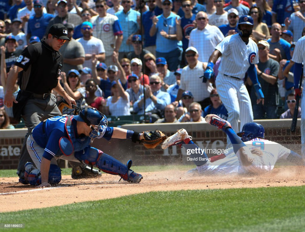 Miguel Montero #47 of the Toronto Blue Jays tags out Javier Baez #9 of the Chicago Cubs at home plate during the second inning on August 18, 2017 at Wrigley Field in Chicago, Illinois.