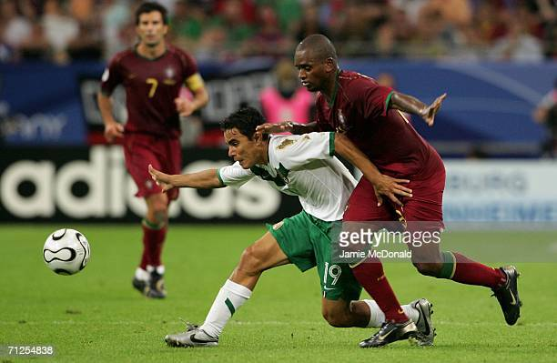 Miguel of Portugal and Omar Bravo of Mexico battle for the ball during the FIFA World Cup Germany 2006 Group D match between Portugal and Mexico at...