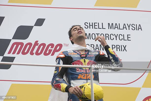 Miguel Oliveira of Portugal and Red Bull KTM Ajo celebrates his victory on the podium at the end of the Moto3 race during the MotoGP Of Malaysia at...