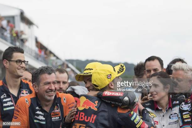 Miguel Oliveira of Portugal and Red Bull KTM Ajo celebrates with Franco Morbidelli of Italy and EG 00 Marc VDS under the podium at the end of the...