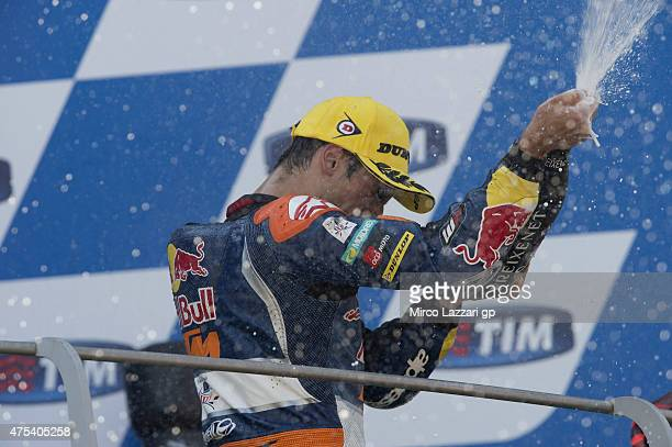 Miguel Oliveira of Portugal and Red Bull KTM Ajo celebrates with champagne on the podium at the end of the Moto3 race during the MotoGp of Italy Race...