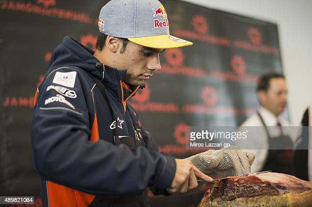 Miguel Oliveira of Portugal and Red Bull KTM Ajo cuts jamon during the preevent 'Iberian Ham Carving Master class guided MotoGP riders will learn how...