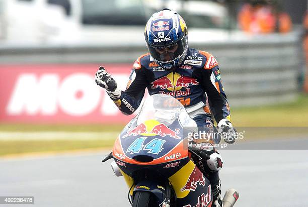 Miguel Oliveira of Portugal and Red Bull KTM Ajo cuts the finish lane and celebrates at the end of the Moto3 race during the MotoGP Of Japan Race at...