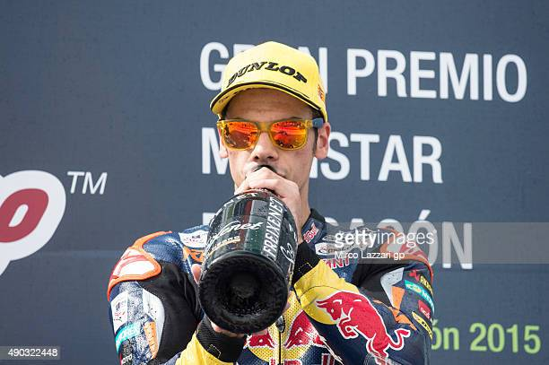 Miguel Oliveira of Portugal and Red Bull KTM Ajo drinks champagne on the podium at the end of the Moto3 race during the MotoGP of Spain Race at...