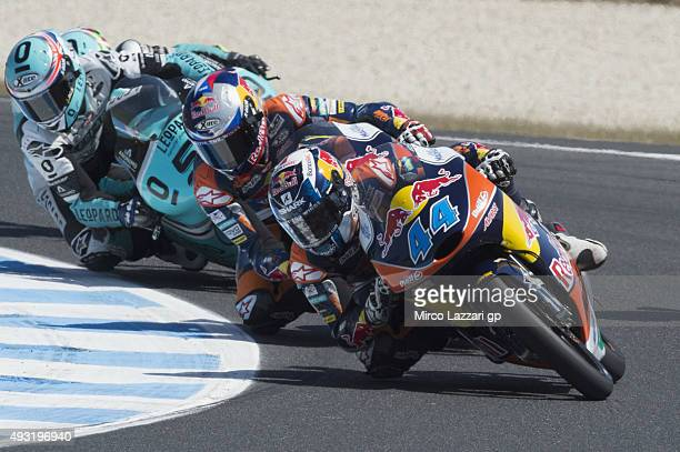 Miguel Oliveira of Portugal and Red Bull KTM Ajo leads the field during the Moto3 race during the MotoGP of Australia Race during the 2015 MotoGP of...