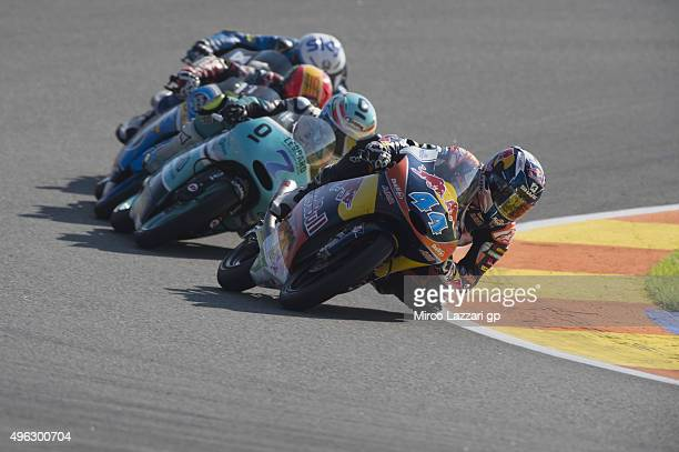 Miguel Oliveira of Portugal and Red Bull KTM Ajo leads the field during the Moto3 race during the MotoGP of Valencia Race at Ricardo Tormo Circuit on...