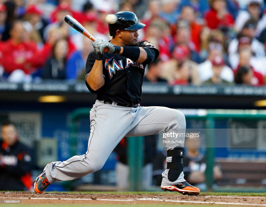 <a gi-track='captionPersonalityLinkClicked' href=/galleries/search?phrase=Miguel+Olivo&family=editorial&specificpeople=209185 ng-click='$event.stopPropagation()'>Miguel Olivo</a> #21 of the Miami Marlins backs away from an inside pitch by Cole Hamels #35 of the Philadelphia Phillies in a MLB baseball game on May 4, 2013 at Citizens Bank Park in Philadelphia, Pennsylvania. The Marlins defeated the Phillies 2-0.