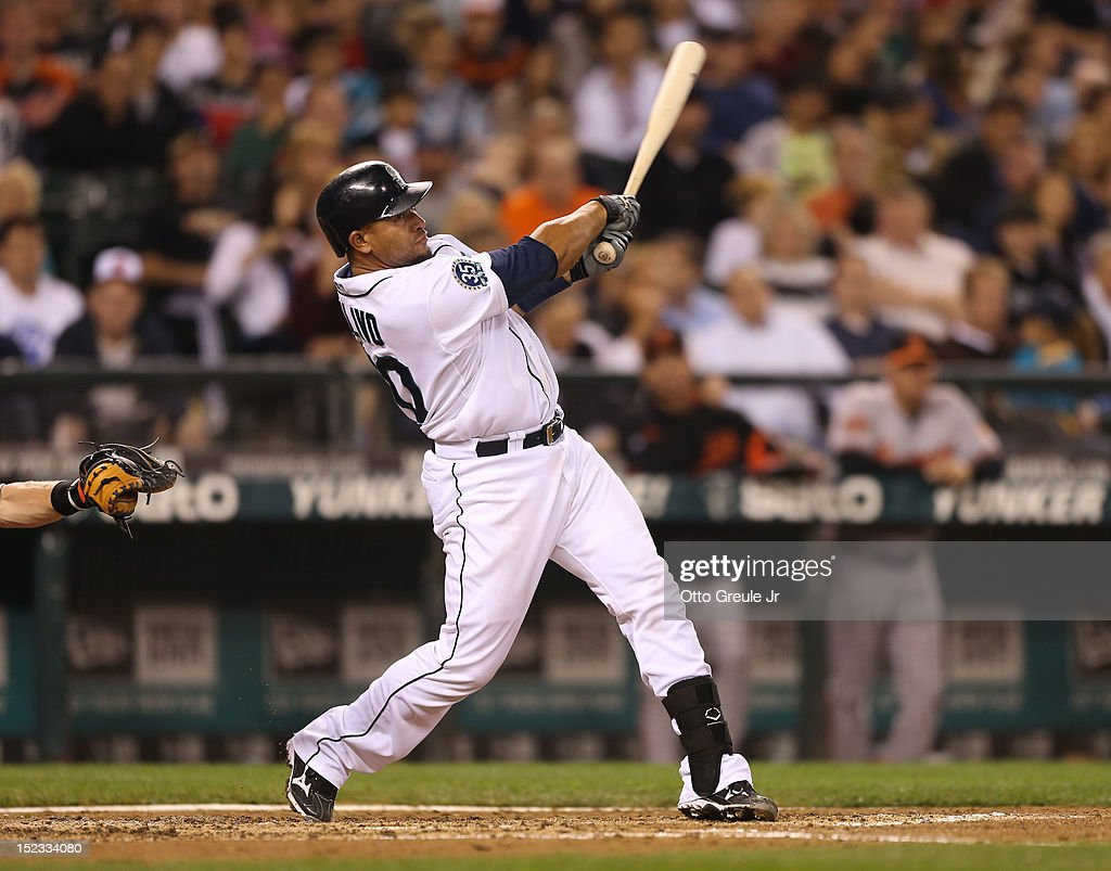 <a gi-track='captionPersonalityLinkClicked' href=/galleries/search?phrase=Miguel+Olivo&family=editorial&specificpeople=209185 ng-click='$event.stopPropagation()'>Miguel Olivo</a> #30 of the Seattle Mariners hits a two-run homer against the Baltimore Orioles at Safeco Field on September 18, 2012 in Seattle, Washington.