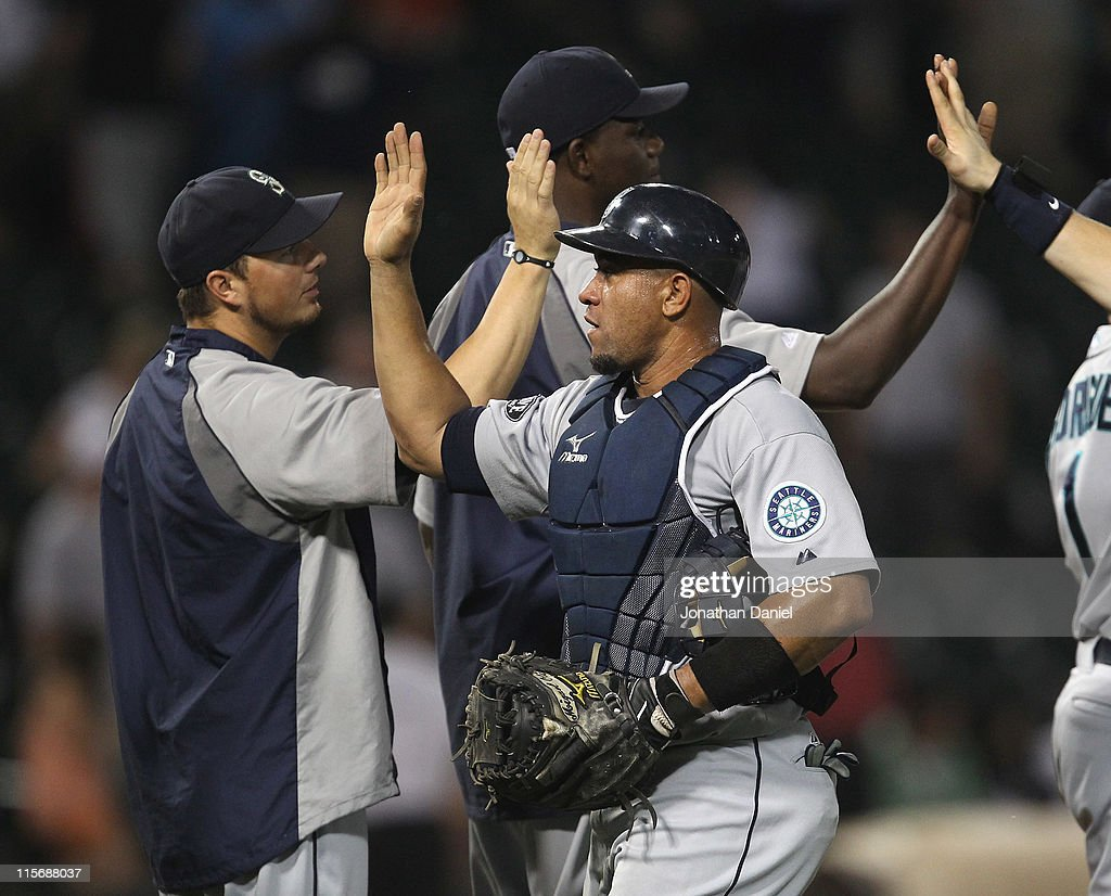 <a gi-track='captionPersonalityLinkClicked' href=/galleries/search?phrase=Miguel+Olivo&family=editorial&specificpeople=209185 ng-click='$event.stopPropagation()'>Miguel Olivo</a> #30 of the Seattle Mariners is congratulated by teammates after a win against the Chicago White Sox at U.S. Cellular Field on June 8, 2011 in Chicago, Illinois. The Mariners defeated the White Sox 7-4 in 10 innings.