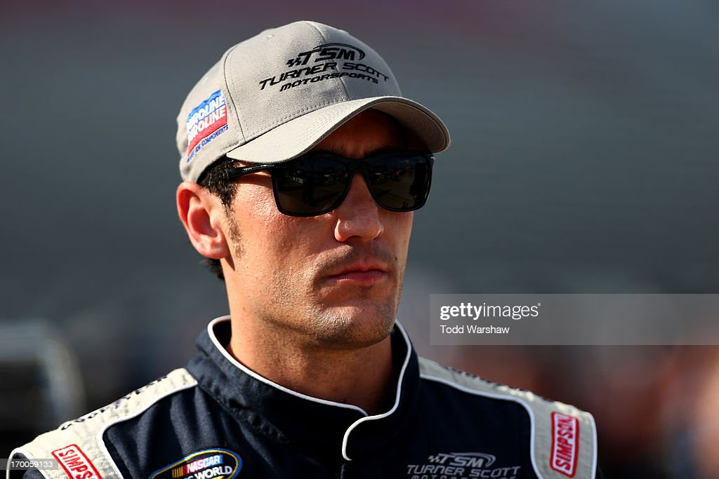 Miguel Paludo, driver of the #32 Duroline Chevrolet, looks on during qualifying for NASCAR Camping World Truck Series WinStar World Casino 400 at Texas Motor Speedway on June 6, 2013 in Fort Worth, Texas.