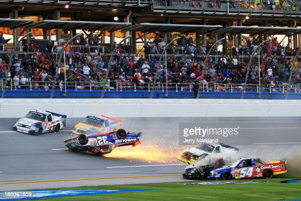 Miguel Paludo driver of the Duroline Chevrolet slides down the track on his roof as Darrell Wallace Jr driver of the Camping World / Good Sam Toyota...