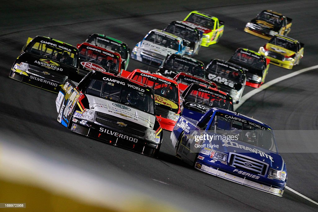 Miguel Paludo, driver of the #32 Leavine Children's Hospital Chevrolet, and <a gi-track='captionPersonalityLinkClicked' href=/galleries/search?phrase=Brad+Keselowski&family=editorial&specificpeople=890258 ng-click='$event.stopPropagation()'>Brad Keselowski</a>, driver of the #2 Draw Tite Ford, lead a pack of trucks during the NASCAR Camping World Truck Series North Carolina Education Lottery 200 at Charlotte Motor Speedway on May 17, 2013 in Concord, North Carolina.