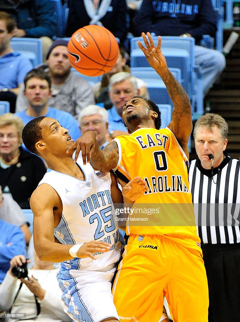 Miguel Paul #0 of the East Carolina Pirates loses control of the ball as he is defende by J.P.Tokoto #25 the North Carolina Tar Heels during play at the Dean Smith Center on December 15, 2012 in Chapel Hill, North Carolina. North Carolina won 93-87.