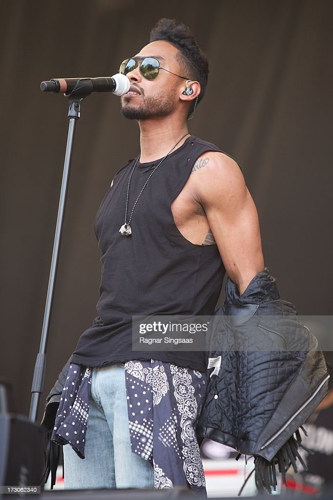 <a gi-track='captionPersonalityLinkClicked' href=/galleries/search?phrase=Miguel+-+Singer&family=editorial&specificpeople=8842866 ng-click='$event.stopPropagation()'>Miguel</a> performs on stage on Day 4 of Hove Festival 2013 on July 5, 2013 in Arendal, Norway.