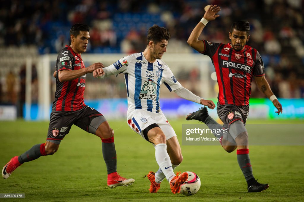 Miguel Ponce (R) and Xavier Baez (L) of Necaxa struggles for the ball with Angelo Sagal (C) of Pachuca during the 12th round match between Pachuca and Necaxa as part of the Torneo Apertura 2017 Liga MX at Hidalgo Stadium on September 30, 2017 in Pachuca, Mexico.