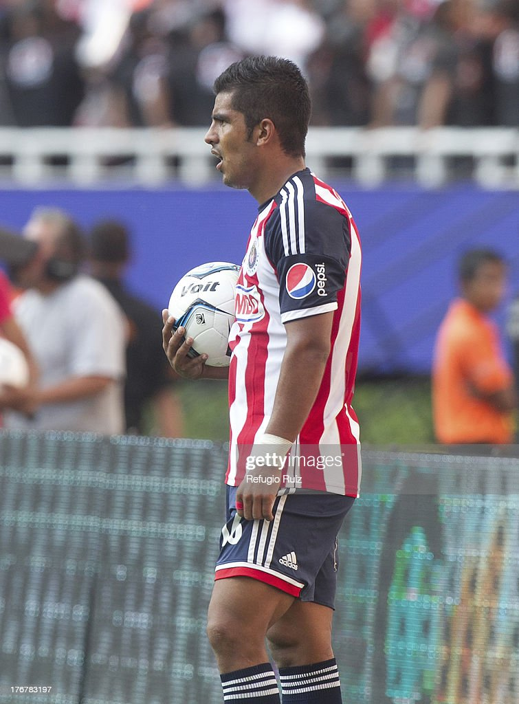 Miguel Ponce of Chivas during a match between Chivas and Puebla as part of the Torneo Apertura Liga MX at the Omnilife Stadium on August 18, 2013 in Guadalajara, Mexico.