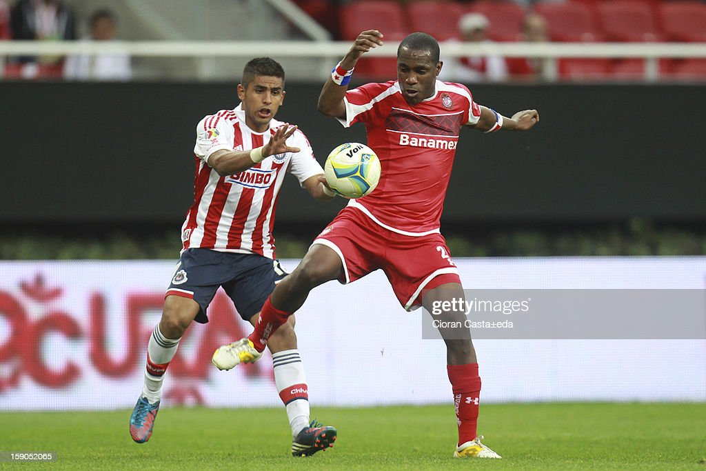 Miguel Ponce of Chivas fights for the ball with Luis Tejada of Toluca during the match between Chivas and Toluca as part of the Clausura 2013 Liga MX tournament at Omnilife Stadium on January 06, 2013 in Guadalajara, Mexico.