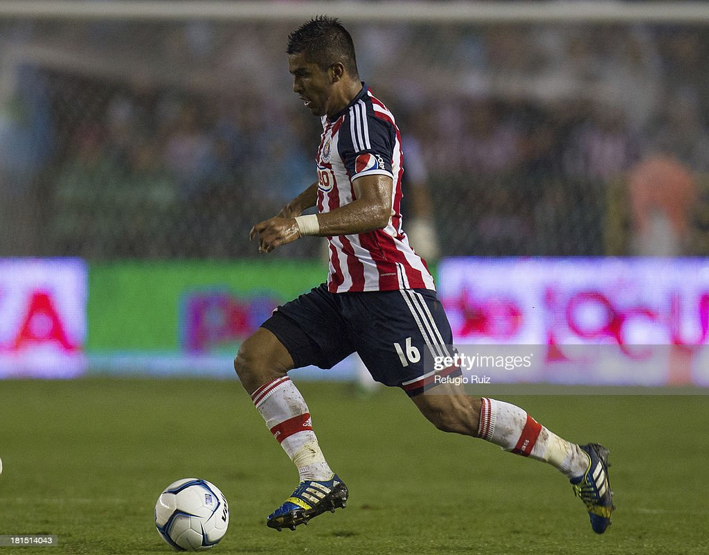 Miguel Ponce runs with the ball during a match between Leon and Chivas as part of the Apertura 2013 Liga MX at Leon Stadium on September 21, 2013 in Leon, Mexico.
