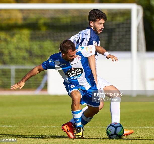 Miguel Real of Club Silva SD competes for the ball with Emre Çolak of Deportivo de La Coruna during the preseason friendly match between Club Silva...