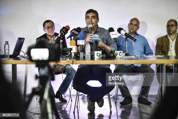 Miguel Rodriguez Torres former Venezuelan interior minister center speaks during a press conference in Caracas Venezuela on Tuesday June 27 2017...