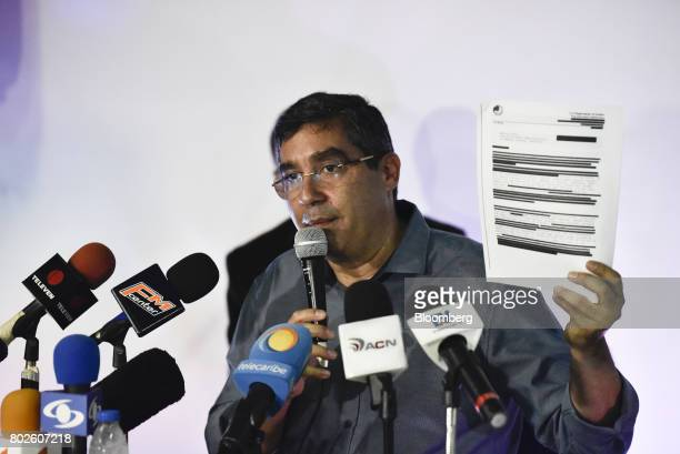 Miguel Rodriguez Torres former Venezuelan interior minister holds out documents for members of the media that allegedly accuse Torres of working with...