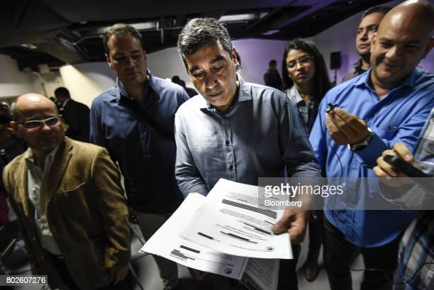 Miguel Rodriguez Torres former Venezuelan interior minister holds out documents for members of the media that allegedly accuse him of working with...