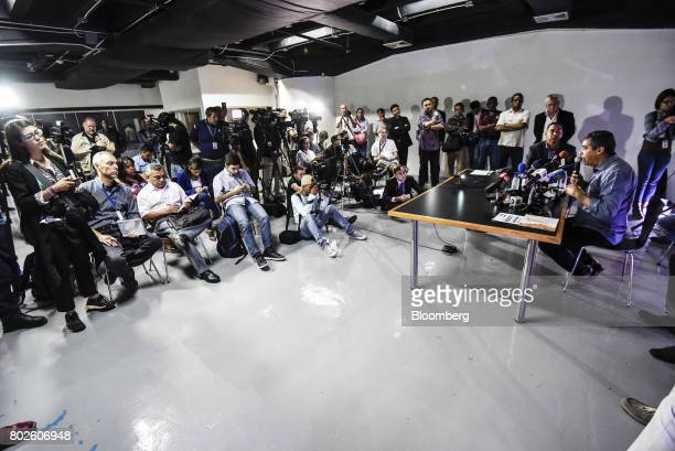 Miguel Rodriguez Torres former Venezuelan interior minister right speaks during a press conference in Caracas Venezuela on Tuesday June 27 2017...