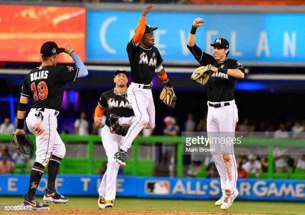 Miguel Rojas Giancarlo Stanton Dee Gordon and Christian Yelich of the Miami Marlins celebrate the win after the game between the Miami Marlins and...