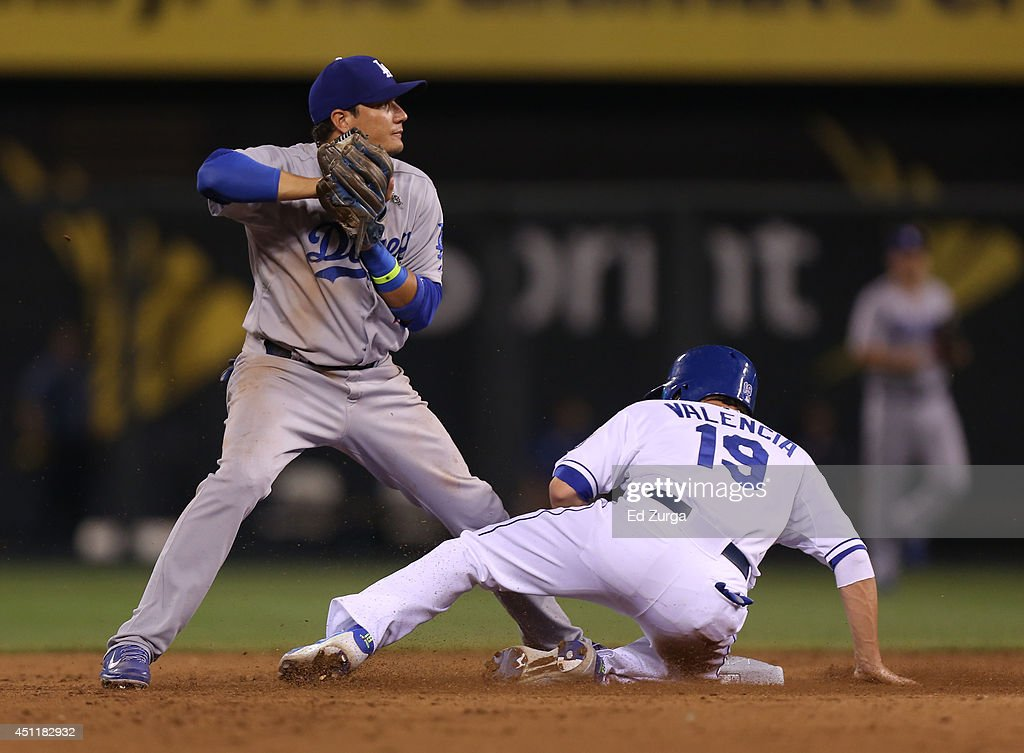 Miguel Rojas #72 of the Los Angeles Dodgers steps on second to get the force out on <a gi-track='captionPersonalityLinkClicked' href=/galleries/search?phrase=Danny+Valencia&family=editorial&specificpeople=5443820 ng-click='$event.stopPropagation()'>Danny Valencia</a> #19 of the Kansas City Royals in the seventh inning at Kauffman Stadium on June 24, 2014 in Kansas City, Missouri.