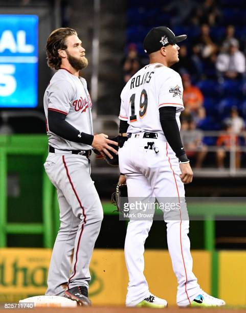 Miguel Rojas of the Miami Marlins and Bryce Harper of the Washington Nationals in action during the game between the Miami Marlins and the Washington...