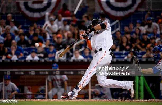 Miguel Rojas of the Miami Marlins at bat during the game against the New York Mets at Marlins Park on April 13 2017 in Miami Florida