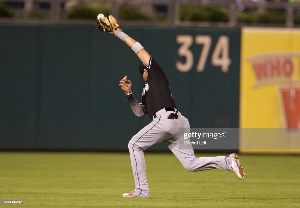 Miguel Rojas #19 of the Miami Marlins cannot make the catch on a ball hit by Pedro Florimon #18 of the Philadelphia Phillies (NOT PICTURED) in the bottom of the fifth inning at Citizens Bank Park on August 23, 2017 in Philadelphia, Pennsylvania. The Phillies defeated the Marlins 8-0.