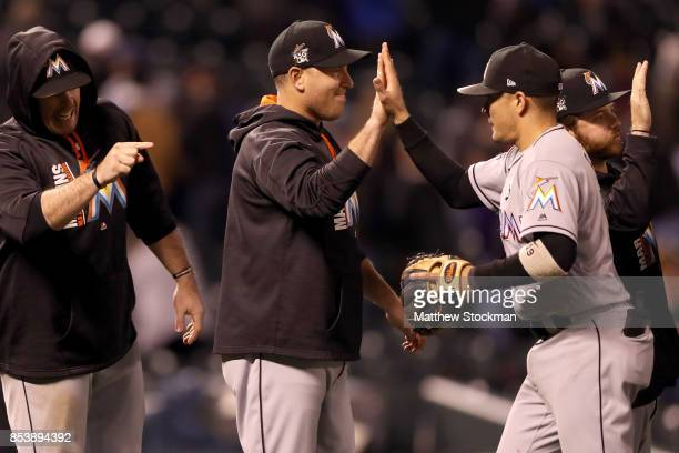 Miguel Rojas of the Miami Marlins celebrates with his teammates their win over the Colorado Rockies at Coors Field on September 25 2017 in Denver...