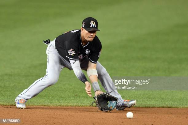 Miguel Rojas of the Miami Marlins fields a ground ball during a baseball game against the Washington Nationals at Nationals Park on August 9 2017 in...