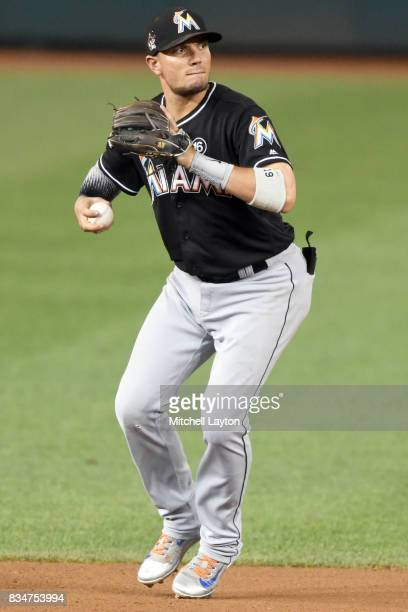 Miguel Rojas of the Miami Marlins fields ground ball during a baseball game against the Washington Nationals at Nationals Park on August 9 2017 in...