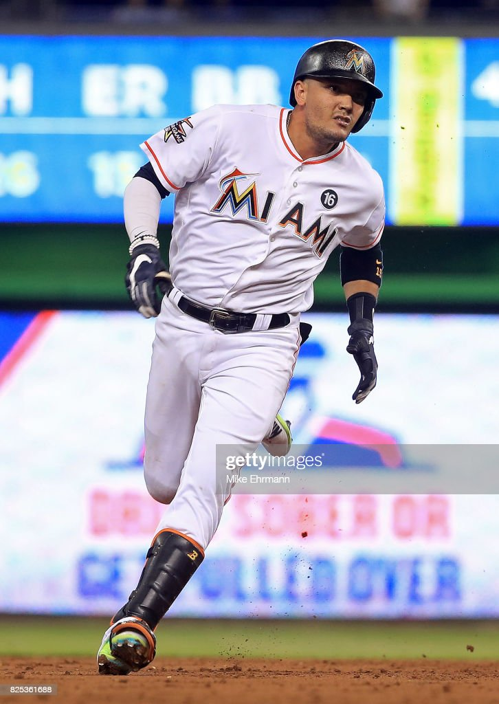 Miguel Rojas #19 of the Miami Marlins heads to third on a triple during a game against the Washington Nationals at Marlins Park on August 1, 2017 in Miami, Florida.