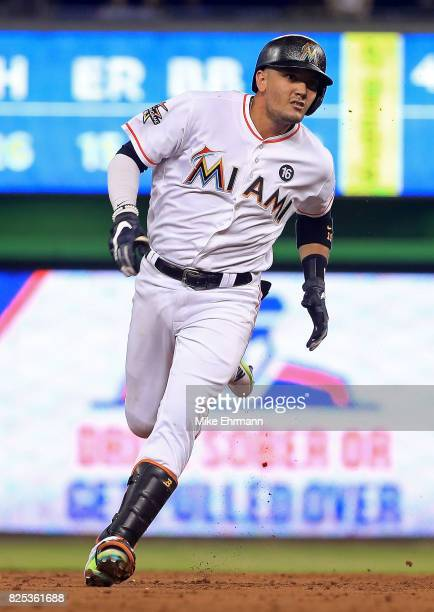 Miguel Rojas of the Miami Marlins heads to third on a triple during a game against the Washington Nationals at Marlins Park on August 1 2017 in Miami...