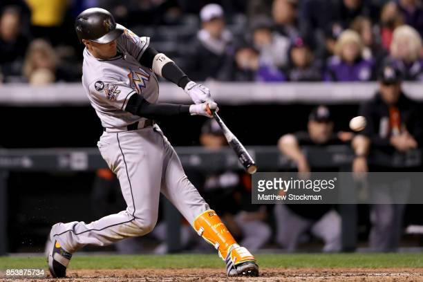 Miguel Rojas of the Miami Marlins hits a 3 RBI double in the fourth inning against the Colorado Rockies at Coors Field on September 25 2017 in Denver...