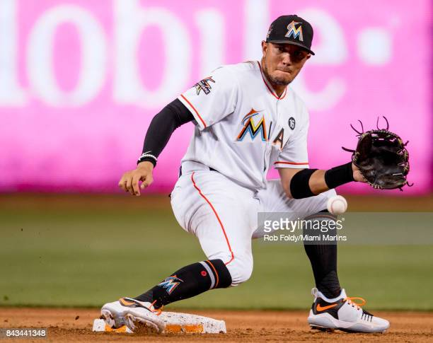 Miguel Rojas of the Miami Marlins in action during the game against the Colorado Rockies at Marlins Park on August 11 2017 in Miami Florida
