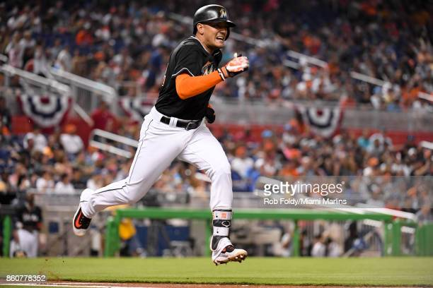 Miguel Rojas of the Miami Marlins in action running to first base during the game against the New York Mets at Marlins Park on April 15 2017 in Miami...