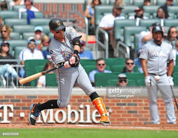 Miguel Rojas of the Miami Marlins knocks in a run with a secong inning single against the Atlanta Braves at SunTrust Park on September 10 2017 in...