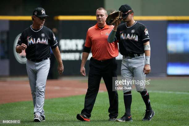 Miguel Rojas of the Miami Marlins leaves the game after being injured in the second inning against the Milwaukee Brewers at Miller Park on September...